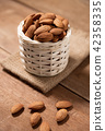 Almond snack fruit in white basket on wooden 42358335