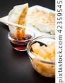 hand with chopsticks dumplings gyoza snack 42359545