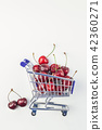 Ripe cherries in a shopping cart isolated 42360271