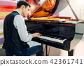 Male pianist at the classical black grand piano 42361741