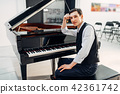 Professional pianist at the black grand piano 42361742
