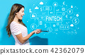 Fintech theme with young woman using tablet 42362079