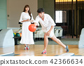 Young couple playing bowling at the sport club. 42366634