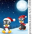 Christmas penguins in the snow 42371069