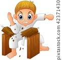 Cartoon Young boy breaking board 42371430