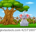 Animal elephant beside a tree inside the fence 42371607