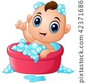 Funny little baby having bath with soap foam 42371686