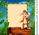 Cartoon monkey standing on hollow log near 42373327