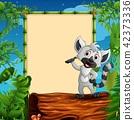Raccoon presenting on hollow log near the empty 42373336