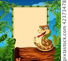Rattlesnake on hollow log near the empty framed 42373478