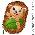 Cartoon hedgehog with holding leaf and waving hand 42376821