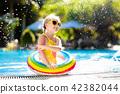 Child in swimming pool. Kids swim. Water play. 42382044