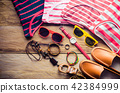 clothing for women, placed on a wooden floor. 42384999