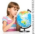 Little girl is examining globe 42390832