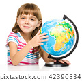 Little girl is examining globe 42390834