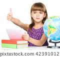 Little girl is using tablet 42391012