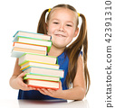 Little girl with books 42391310