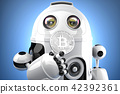 Robot looking at bitcoin coin in his hands 42392361
