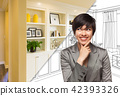 Young Woman Over Custom Built-in Shelves and Cabinets Design Dra 42393326