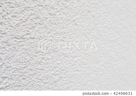 Pattern of white rock plastered stucco wall 42406631