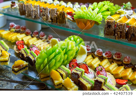 Set of delicious sweet cakes and dessert 42407539