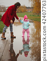puddle, mother, girl 42407763