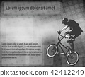 BMX stunt cyclist over abstract background 42412249