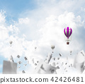 Flying hot air balloons in the air. 42426481