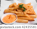 French fries with sauce on plate. 42435581