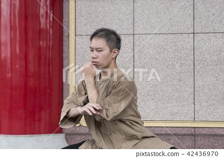 Martial artist practicing Tai Chi 42436970