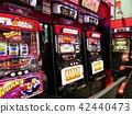 slot machine in a pachinko parlor, slingshot, pachinko 42440473