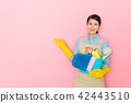 woman holding a box of cleaning tools 42443510