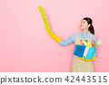 confident woman swaying a yellow feather stick 42443515