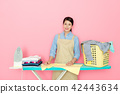 beautiful Asian woman doing the ironing 42443634