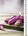 Heap of small eggplant or aubergine 42444020