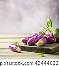 Heap of small eggplant or aubergine 42444022