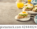 Sandwich with avocado and fried eggs 42444024