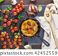 omelette from chicken eggs with  cherry tomatoes 42452559