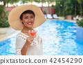 Woman enjoying summer cocktail 42454290