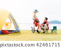 couple having a good time together while camping 42461715