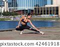Woman warming up on embankment 42461918