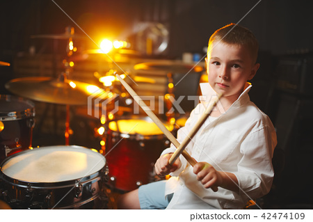 boy plays drums in recording studio 42474109