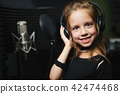 little girl singing in recording studio 42474468