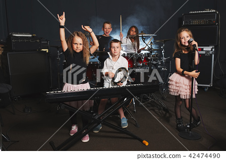 happy children singing and playing music 42474490