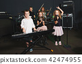 happy children singing and playing music 42474955