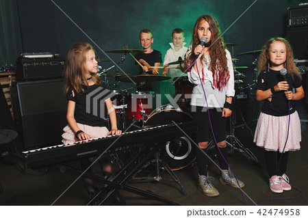 happy children singing and playing music 42474958