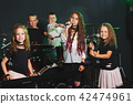 happy children singing and playing music 42474961