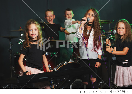 happy children singing and playing music 42474962