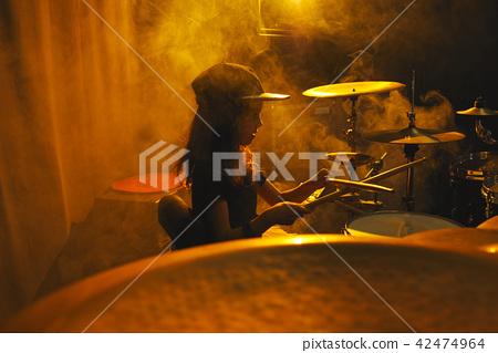 boy plays drums in recording studio 42474964