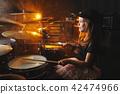 boy plays drums in recording studio 42474966